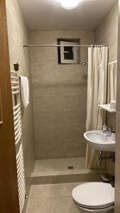 A bathroom at Lux Apartments