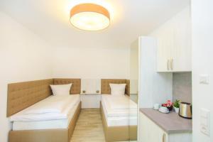 Ein Bett oder Betten in einem Zimmer der Unterkunft Hotel Filderhof Reutlingen
