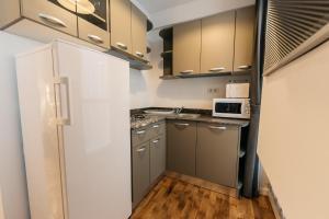 מטבח או מטבחון ב-YellowBoot Aparthotel