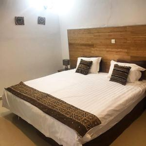 A bed or beds in a room at Harmony Resort Boutique Hotel