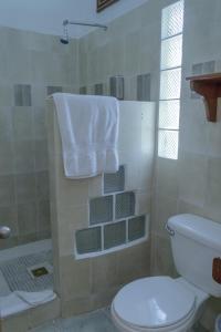 A bathroom at Hotel Jaguar Inn Tikal