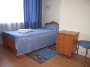 Кровать или кровати в номере Гостиница на Казанской