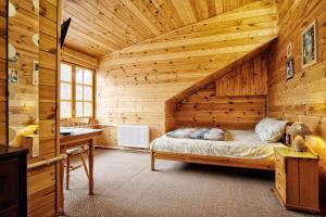 Кровать или кровати в номере Гостевой Дом Рябушинка