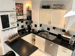 Küche/Küchenzeile in der Unterkunft Ferienhaus am Holzweg