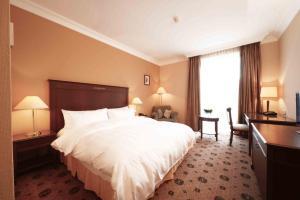 Кровать или кровати в номере Lotte City Hotel Tashkent Palace