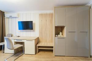 A television and/or entertainment center at Nadezhda Health Resort