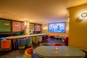 The lounge or bar area at OMAMA Hotel