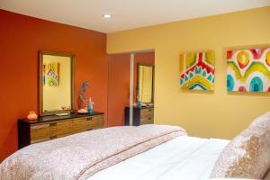 Cama ou camas em um quarto em Arashi Beachfront Villa