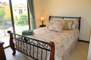 Cama ou camas em um quarto em Casa Diamante