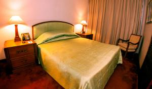 A bed or beds in a room at Pan Pacific Sonargaon Dhaka