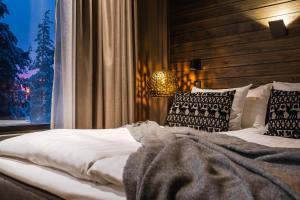 Säng eller sängar i ett rum på Lapland Hotels Sky Ounasvaara