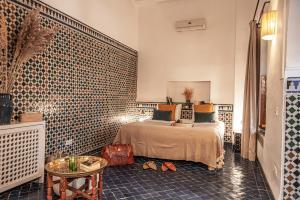Cama o camas de una habitación en Riad Palais Calipau
