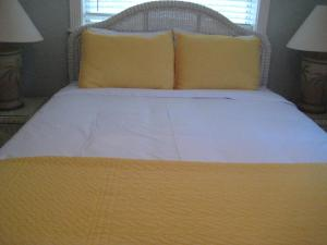 A bed or beds in a room at Pirates Pointe Resort