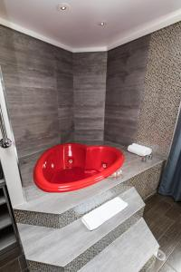 A bathroom at Ramada by Wyndham Bronx