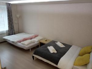 A bed or beds in a room at Квартира на Связи 8