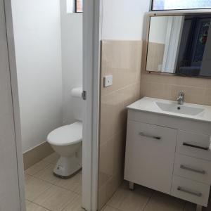 A bathroom at Forster and Wallis Lake Motel