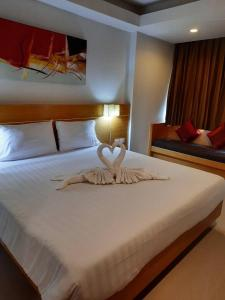 Cama ou camas em um quarto em Aspery Hotel