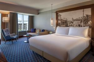 A bed or beds in a room at Renaissance Izmir Hotel