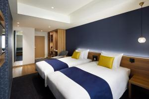 A bed or beds in a room at the b akasaka-mitsuke
