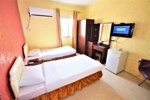 A bed or beds in a room at Sur Hotel