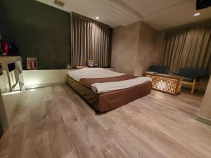 A bed or beds in a room at Hotel J Club