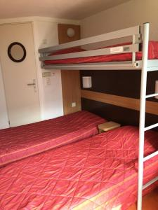 A bunk bed or bunk beds in a room at Premiere Classe Metz Nord - Semecourt