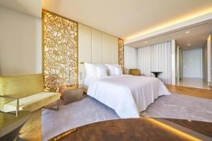A bed or beds in a room at Savoy Palace - The Leading Hotels of the World - Savoy Signature