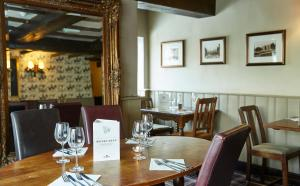 A restaurant or other place to eat at Dog & Partridge Hotel by Greene King Inns
