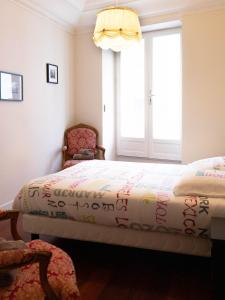 A bed or beds in a room at CANNES CROISETTE - CARRE&OR