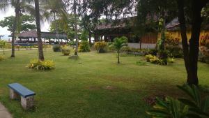 A garden outside Hotel Praia do Encanto
