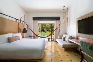 A bed or beds in a room at Los Sueños Marriott Ocean & Golf Resort