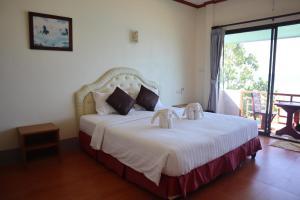 Ein Bett oder Betten in einem Zimmer der Unterkunft Bamboo @ Koh Chang