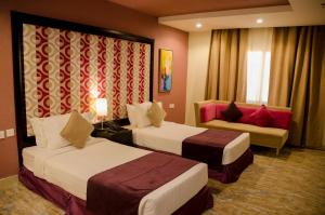 A bed or beds in a room at Swiss Spirit Hotel & Suites Taif