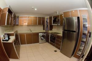 A kitchen or kitchenette at Swiss Spirit Hotel & Suites Taif