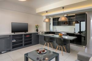 A kitchen or kitchenette at Spring Apartments