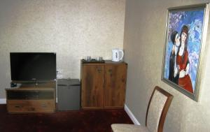 A television and/or entertainment center at Kera Hotel