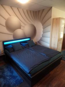 Postel nebo postele na pokoji v ubytování Apartmány City
