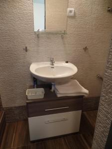 Koupelna v ubytování Apartmány City