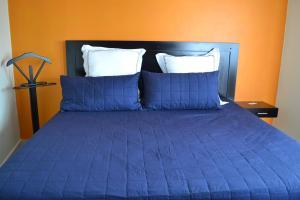 Cama o camas de una habitación en Hotel Sierra Patlachique