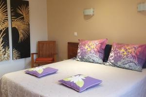 Un ou plusieurs lits dans un hébergement de l'établissement Residence Les Lataniers