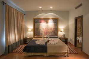 Cama o camas de una habitación en Parador de Trujillo