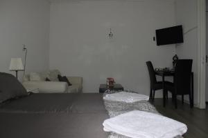 Ein Bett oder Betten in einem Zimmer der Unterkunft Studio Slijterij Zandvoort