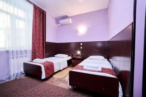 A bed or beds in a room at Hotel Korona