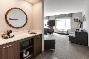 A television and/or entertainment center at Hampton Inn & Suites Beauport Quebec