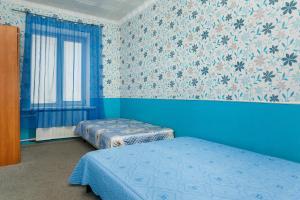 Кровать или кровати в номере Апартаменты на проспекте Ленина 97
