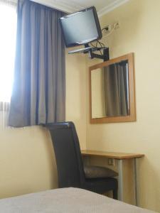 Televisor o centre d'entreteniment de Hostal El Callejón