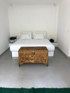 A bed or beds in a room at The Moroccans Private Suites