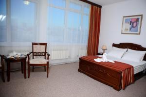 Кровать или кровати в номере Отель Сибирь
