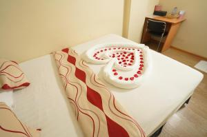 A bed or beds in a room at 15th street @ Downtown Yangon