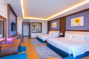 A bed or beds in a room at Vung Tau Riva Hotel